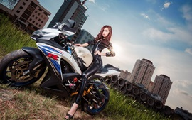 Asian girl and Suzuki GSX-R motorcycle