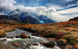 Beautiful nature, mountains, grass, creek, clouds