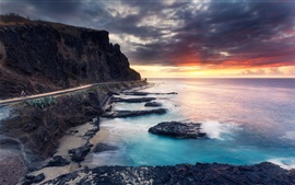 Beautiful sunset sea, coast, road, clouds