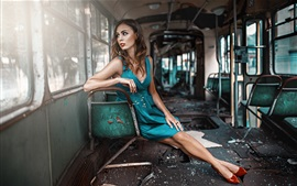 Blue dress girl sit in old car