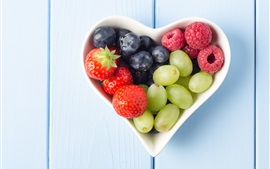 Preview wallpaper Fruits, heart shaped cup, strawberries, blueberries, grapes, raspberries