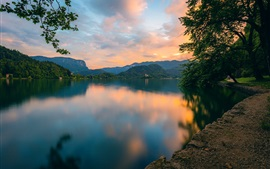 Preview wallpaper Lake Bled, Slovenia, mountains, trees, clouds, sunset