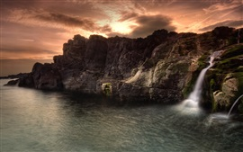 Preview wallpaper Lake, rocks, waterfall, clouds, sunset