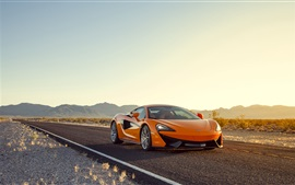 McLaren 570S orange supercar at sunset