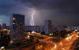 Preview wallpaper Moscow night city, lightning, road, houses, lights