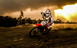 Preview wallpaper Motorcycle racing, sun, clouds, dusk