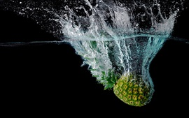 Pineapple fall to the water, splash, bubbles