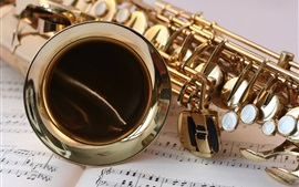 Saxophone close-up, music stave