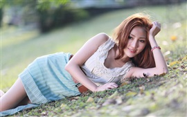 Smile Asian girl lying ground