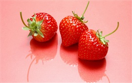 Preview wallpaper Three strawberries, sweet fruits