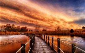 Preview wallpaper Wooden bridge, river, grass, nature sunset, clouds, red sky