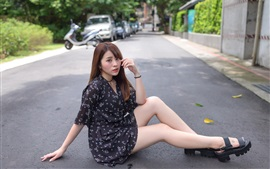 Preview wallpaper Asian girl sit at the road