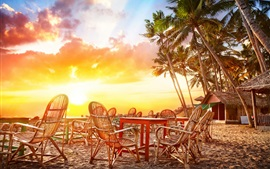 Preview wallpaper Beach sunset, palm trees, house, chairs, table