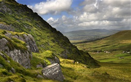 Beautiful Ireland nature landscape, mountains, grass, clouds