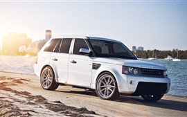 Preview wallpaper Land Rover white car at city beach