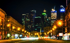 Preview wallpaper Moscow city night, Russia, road, houses, skyscrapers, lights, illumination