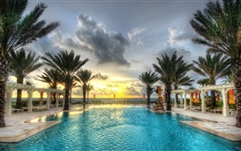 Preview wallpaper Palm trees, swimming pool, resort, sunset, clouds, sea