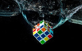 Preview wallpaper Rubik's cube falling in water