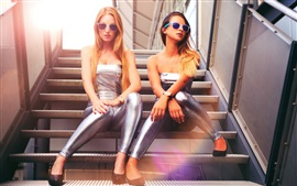Silver dress girls sit at stairs, glasses, blonde