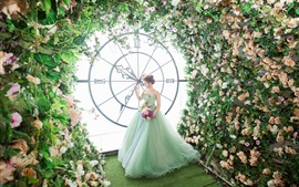 Bride, big clock, flowers, art photography