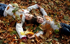 Preview wallpaper Children, two smile little girls, joy, leaves, autumn