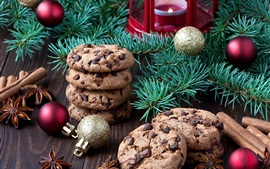 Christmas food, chocolate cookies, tree branches, balls, candle