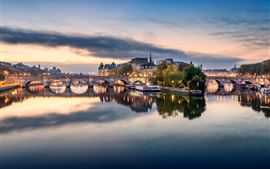 Preview wallpaper France, Paris, bridge, river, boats, houses, clouds, dusk