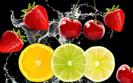 Preview wallpaper Fruits in the water, cherries, strawberries, lemon
