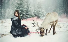 Preview wallpaper Girl and deer in the winter