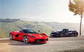 Preview wallpaper McLaren black supercar and Ferrari LaFerrari red supercar