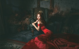 Red dress Asian girl in the room