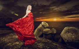 Preview wallpaper Red dress girl at sunset coast, stones