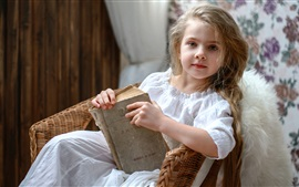 Russia cute little girl reading book