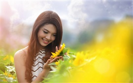 Summer smile Asian girl and sunflower