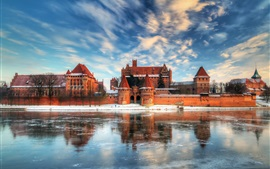 Travel to Poland, castle, lake, water reflection, winter, snow