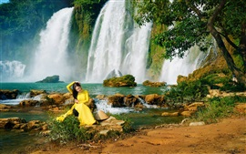Preview wallpaper Yellow dress Asian girl, waterfalls, water, trees