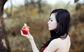 Preview wallpaper Asian girl side view, hand, apple