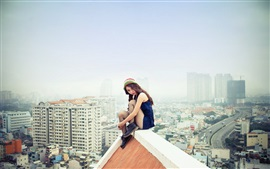 Asian girl sitting at roof, city, dangerous