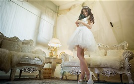 Preview wallpaper Asian girl, white skirt, pose, sofa, room