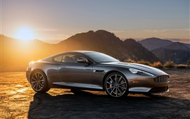 Aston Martin DB9 cinza supercar no por do sol