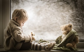 Preview wallpaper Cute boy and teddy bear at window side