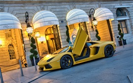 Lamborghini Aventador LP700-4 yellow supercar at street, doors opened