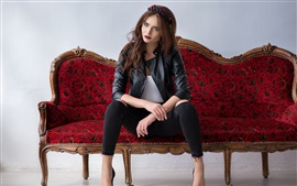 Leather jacket girl sit on sofa