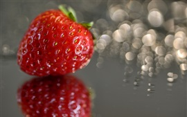 Preview wallpaper One strawberry close-up, glare background