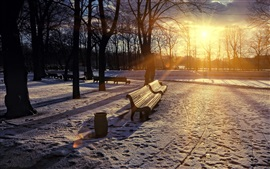 Preview wallpaper Park in winter, sunrise, snow, trees, bench, sun rays