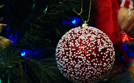 Red Christmas ball close-up, white decoration