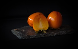 Preview wallpaper Ripe persimmon, fruit close-up, black background