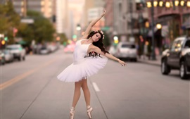 Ballerina dancing at city street