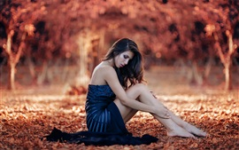 Preview wallpaper Blue dress girl sit in ground, autumn