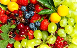 Delicious fruits, grapes, gooseberries, strawberries, blueberries, cherries